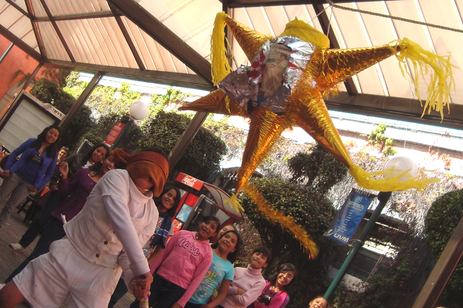 During las posadas in Mexico, piñatas filled with candy are brought to celebration.